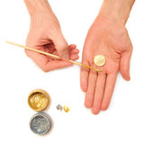Make money. Concept. Hands, coins, gold paint Royalty Free Stock Photos