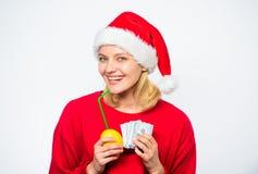 Make money on fresh lemonade. Christmas profit concept. Lemon money concept. Symbol of wealth and richness. Rich girl. With lemon and money. Girl santa hat royalty free stock photos