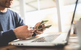 Make Money Online Concept, Man Counting His Cash That He Earned. On Internet Stock Photo