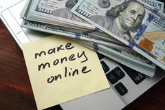 Make money online. Concept on a paper with notebook royalty free stock photography