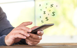 Make Money Online Concept With Smart Phone. On Light Background Royalty Free Stock Photos