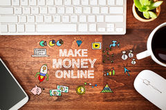 Make Money Online concept with workstation. On a wooden desk Royalty Free Stock Photos