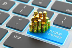 Make money online and internet business concept. Stack of golden coins on computer keyboard button close-up view Royalty Free Stock Images