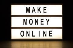 Make money online light box sign board royalty free stock photography