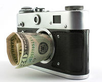Camera and dollar Stock Image