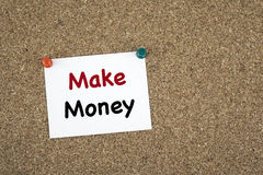 Make Money. Sticky note on cork board.  Royalty Free Stock Photos