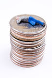 Make money while you sleep Concept. Miniature man sleeping stacks of quarters Stock Image