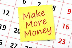 Make More Money. The phrase Make More Money on a yellow sticky note attached to a wall calendar as a reminder or resolution for next year royalty free stock photos