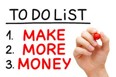 Make More Money To Do List. Hand writing Make More Money in To Do List with red marker isolated on white stock photos