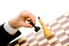 Make the move. A chess player making his next chess move Royalty Free Stock Photography