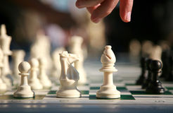 Make a move. Chess game with player about to make a move Stock Photography