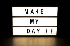 Make my day light box sign board. On wooden table stock photo