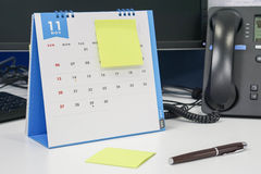 Make note of meeting on November calendar with pen Stock Photos