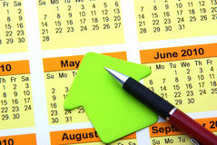 Make notes. Blank post it and pen on a calendar Stock Images