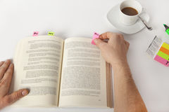 Make notes in a book. Only the hands are seen, no face Stock Images
