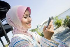 Make a phone call. A young muslim girl is making phone calls Royalty Free Stock Photos