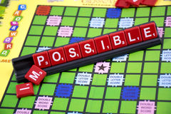 Make it possible. A capture of crossword game with a word (im)possible Stock Photo