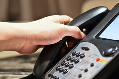 Make or receive a call. The hand picks up the phone to make or receive a call Royalty Free Stock Images
