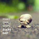 Make Small Steps Every Day. Small brown snail. Stock Images