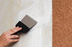 Make a smear for stick cork wallpaper Royalty Free Stock Photos