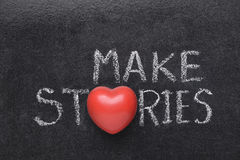Make stories heart. Make stories phrase handwritten on blackboard with heart symbol instead of O Royalty Free Stock Photos