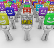 Make Them Smile Words People Happy Good Moods. Make Them Smile words held by a person with a sign spreading good cheer and moods with laughter, humor and Royalty Free Stock Photos