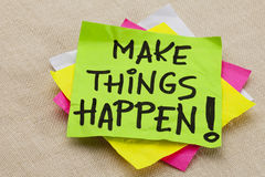 Make things happen. Motivational reminder - handwriting on a green sticky note