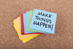 Make things happen. Colorful adhesive notes stack with make things happen message Stock Image