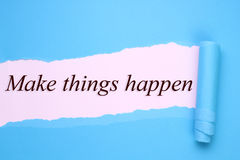 Make things happen. Text torn paper stock photo