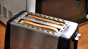 Make toast in the toaster. Closeup stock footage