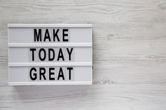 `Make today great` words on  modern board over white wooden background, top view. Overhead, from above. Flat lay. Copy space stock photography