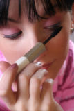Make-up. Young girl making up Stock Images