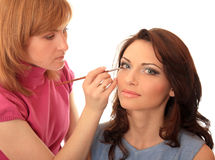 Make-up. Master of style does to the beautiful girl of make-up Royalty Free Stock Photography