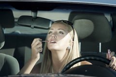 Make-up. In the car Royalty Free Stock Photography