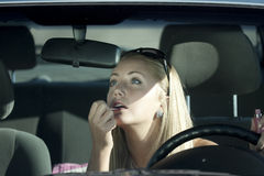 Make-up. In the car Stock Photos