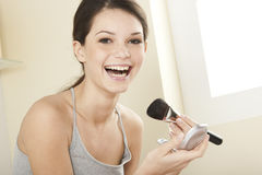 Make Up. Teenage girl applying make up Royalty Free Stock Image