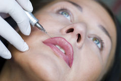 Make up. Image of permanent make-up (tattoo royalty free stock photo