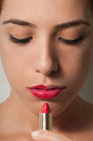 Woman Looking at Lipstick stock photo
