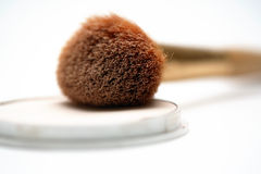 Make-up. A make-up brush and a white background Royalty Free Stock Images