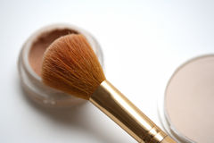 Make-up. A make-up brush and a white background Stock Images