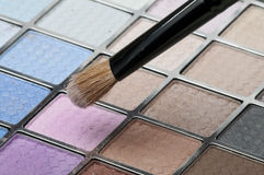 Make-up. Pallete witha paint brush royalty free stock photos