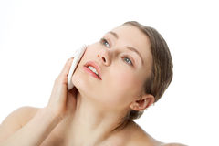 Make up. Young woman with make-up brush Royalty Free Stock Photography