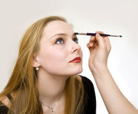 Make-up. A young girl remedies a make-up Royalty Free Stock Photography