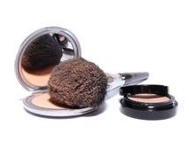 Make-up. Compact powder mirror brush and eye shadow Stock Photography