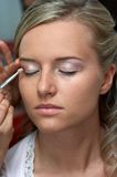 Make-up. Someons is making up pretty girl Stock Photo