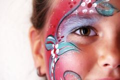 Make up. Little girl with body painted flower face Stock Images