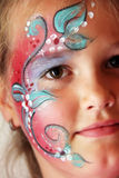 Make up. Little girl with body painted flower face Stock Photography