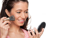 Make up. Full isolated woman doing some make up Royalty Free Stock Photography