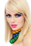 Make-up. Young beautiful  blond woman with fancy make-up and colorful wooden necklaces Royalty Free Stock Photo
