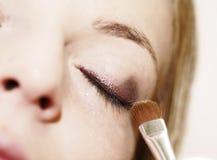 Make-up. Eye - woman applying make up stock photo